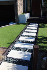 White pavers contrast with black polished 