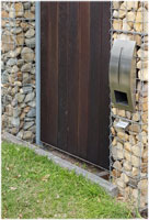 Gabion fenceposts and letterbox