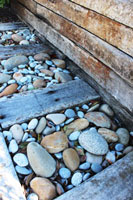 Lucky River Pebbles with natural wood for visual 